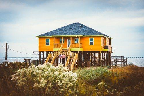 Orange house on stilts